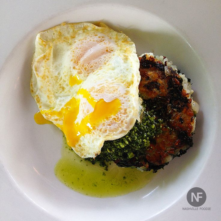 Risotto Cake w/ Kale Pesto and 2 over-easy eggs. BEST brunch in ...