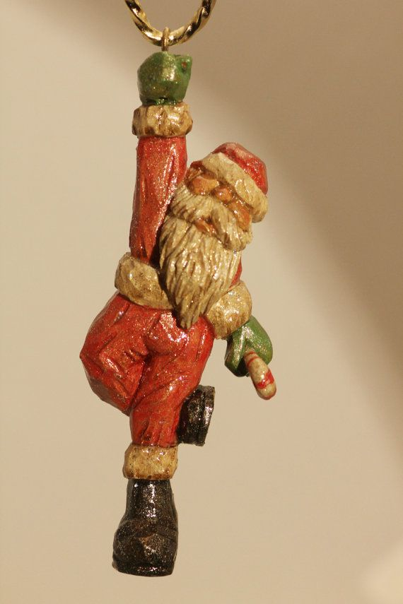 Hand carved wooden santa ornament