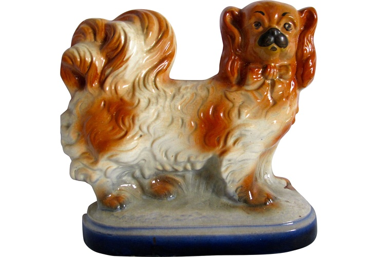 Very sweet antique Staffordshire Pekingese figurine. The chip restoration is done to a high standard and it displays as perfect.