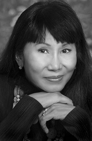 Amy Tan.  My favorite is The Hundred Secret Senses.  Really need to reread.  Her books about Chinese families remind us we are really all the same.