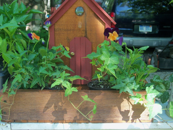 Mock Birdhouse planter box made of Cedar treated w/sikkens. My stepfather Paul made these for me.