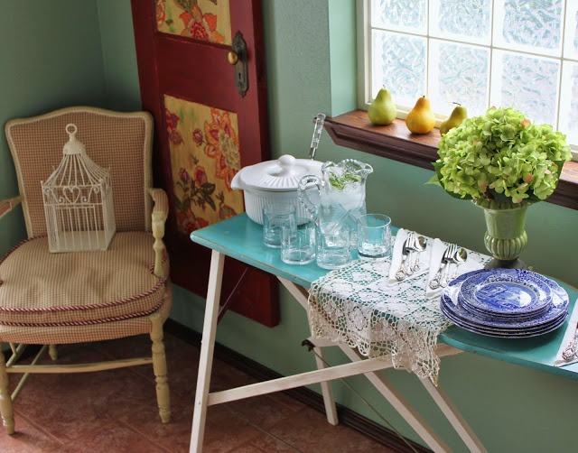 Painted vintage ironing board as sideboard or entry table.