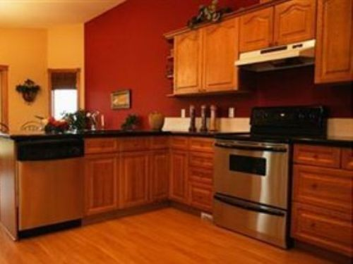 Red Kitchen Walls with Light Oak Cabinets (paint cabinet and hood black, stain doors