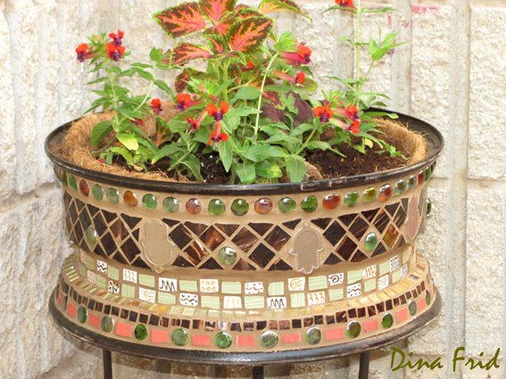 Mosaic art on an old tire rim outdoor life crafts for Old tire art