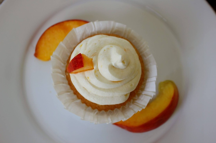 ... Vanilla Cupcake filled with Peach Puree topped with Fresh Peach Butter