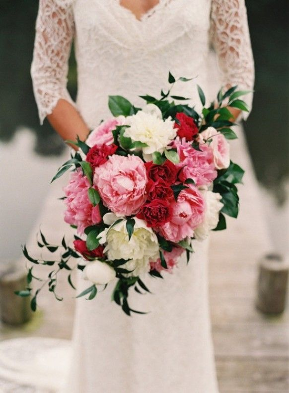 wedding bouquet with pink peonies and red and white roses