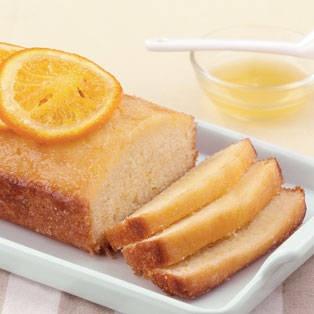 Glazed Orange Pound Cake with candied orange slices, orange zest, and ...