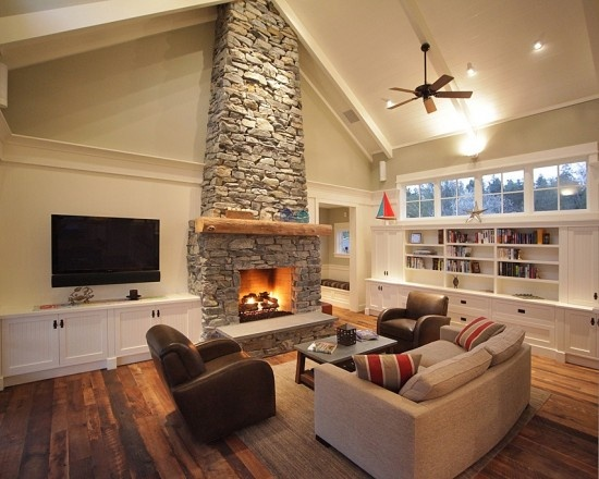 Tv Mounted Next To Stone Fireplace Home Entertainment