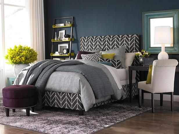 Go Big  The oversized patterns mixed with trendy colors make this space a much desired space for rest and relaxation.