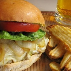 Pesto chicken sandwich with caramelized onions and havarti cheese.