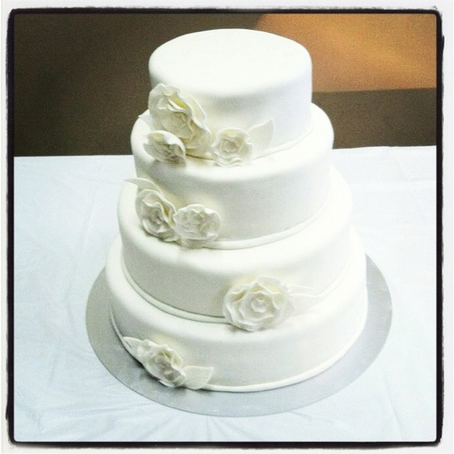 Classic white wedding cake covered in homemade marshmallow fondant ...
