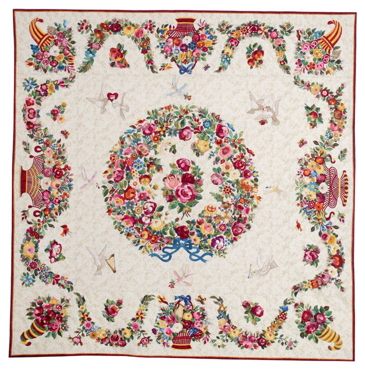 On the Cover: Album of Roses by  Rita Verroca as seen at Quilters Newsletter