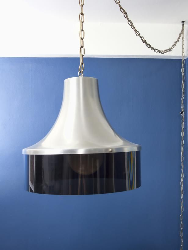 lighting in a rental utilize a pendant lamp that plugs into a wall. Black Bedroom Furniture Sets. Home Design Ideas