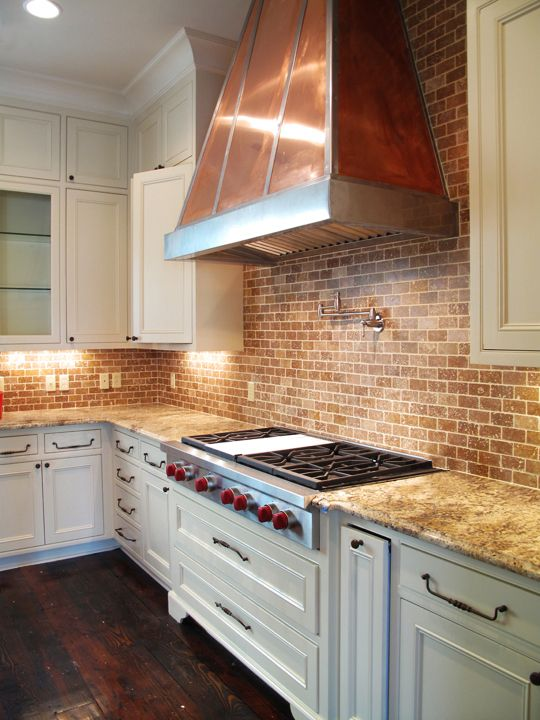 brick backsplash and copper hood would look great with open white