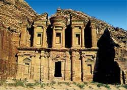 Petra - an ancient city of tombs, temples and other monumental buildings carved into solid sandstone cliffs in arid gorges in southern Jordan.
