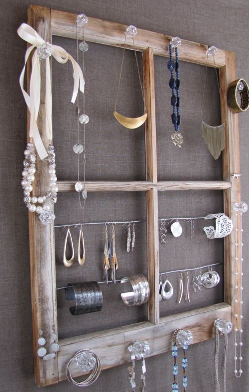 Jewlery Organizer Window... I like the idea of using knobs screwed into wood, not necessarily a window