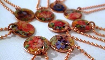 Necklaces made from pennies, embossing powder and decals