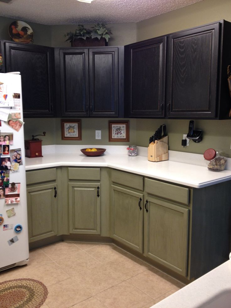 cabinets black and painted the bottom cabinets an olive green with a