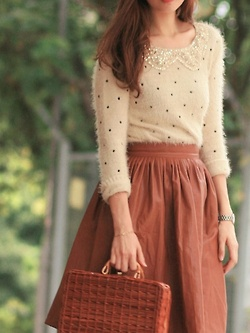 Nice cream sweater with brown skirt and matching handbag