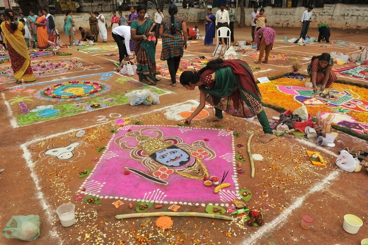 Women in Hyderabad, India, participate in a rangoli competition