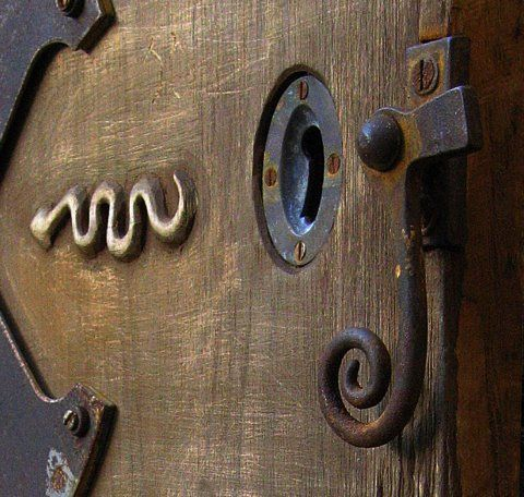 Snake detail on carved door by Robyn Gordon
