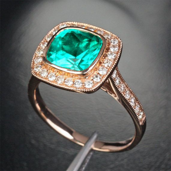 Okay, I changed my mind. This is literally the most beautiful ring on the planet. So different, so unique, and I love the color play. Not to mention that poppy and turqouise would probably be mine and my boy's wedding colors...ah, so pretty :))))