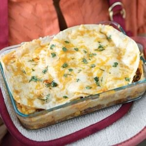 Tex mex lasagna. Made this tonight, awesome! Just use canned pinto ...
