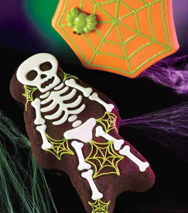 Spooky skeleton and spider web cake pans from @Wilton Cake Decorating!  Exclusive to Jo-Ann Stores!