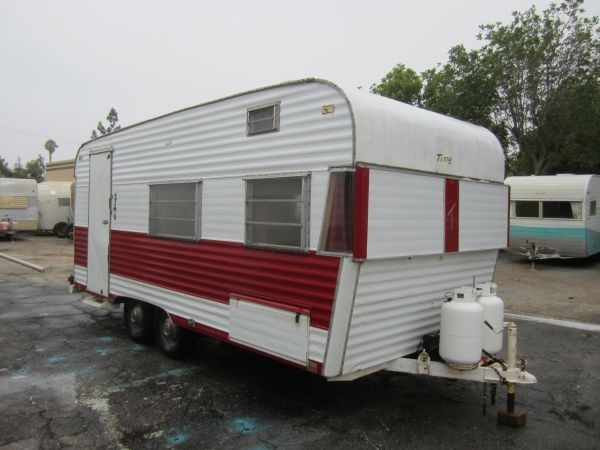 Model  It Looks Because It Is A Hybrid Trailer With Poppingout Side Tents