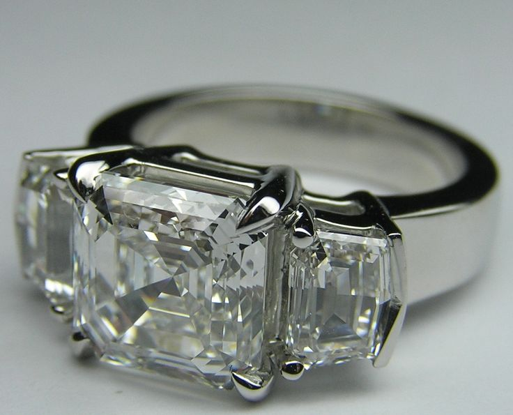 asscher diamond with cadillac side stones...so in love...