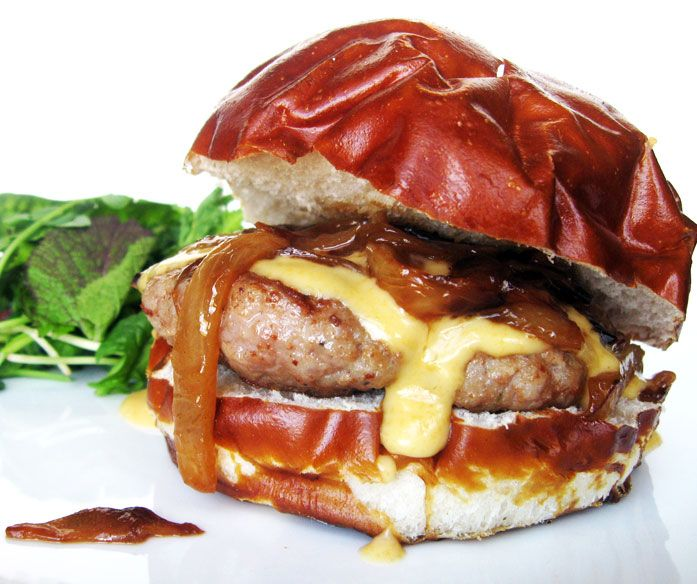 burger made out of brats with beer soaked onions and cheddar cheese
