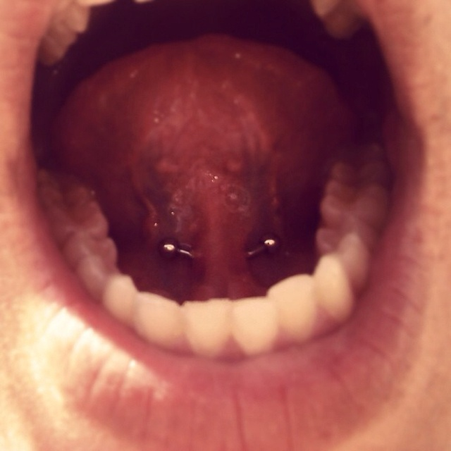 how to clean tongue web piercing