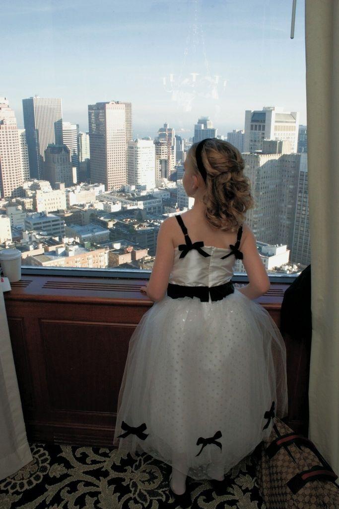 lovely little flower girl admiring the view