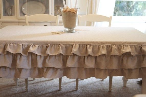 ruffled tablecloth, i used to think ruffles were only for bull fighters and court jesters and now i love them.