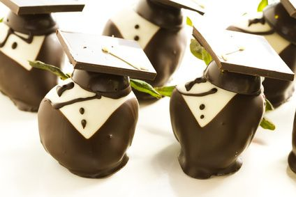 Graduation party food Little chocolate covered strawberries shaped like a cap and gown.