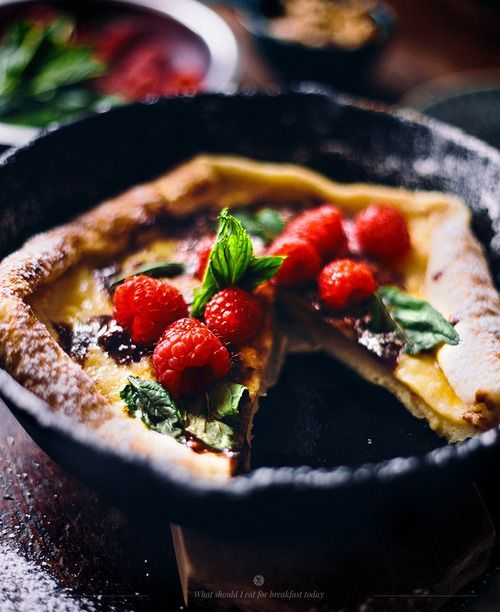 Dutch baby with chocolate, raspberries and mint.