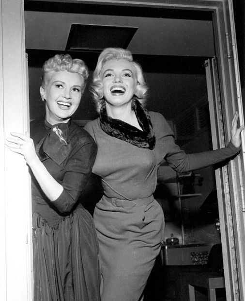 Betty Grable and Marilyn Monroe on the set of How TO MARRY A MILLONAIRE