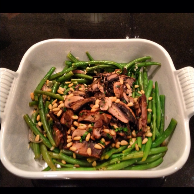 ... with white wine, garlic and thyme. And... toasted pine nuts to finish