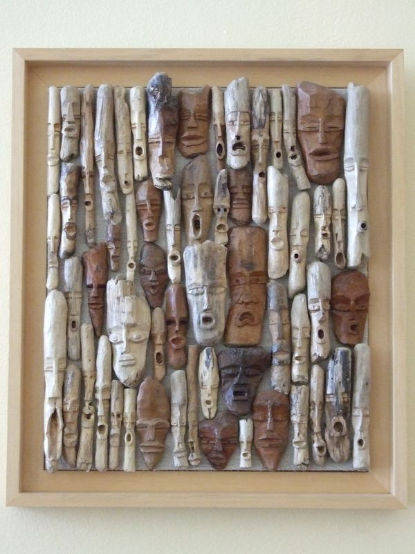 Driftwood faces ...awesome art piece.