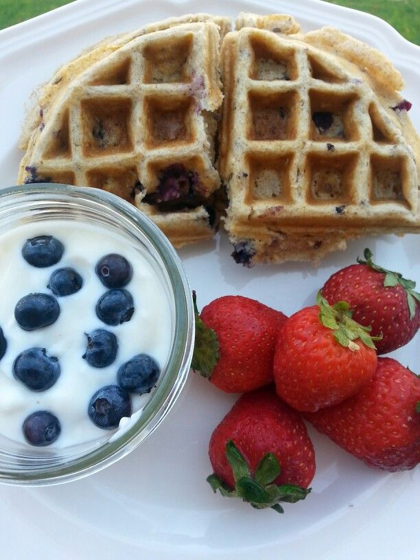 Blueberry multigrain waffles w yogurt and fresh berries