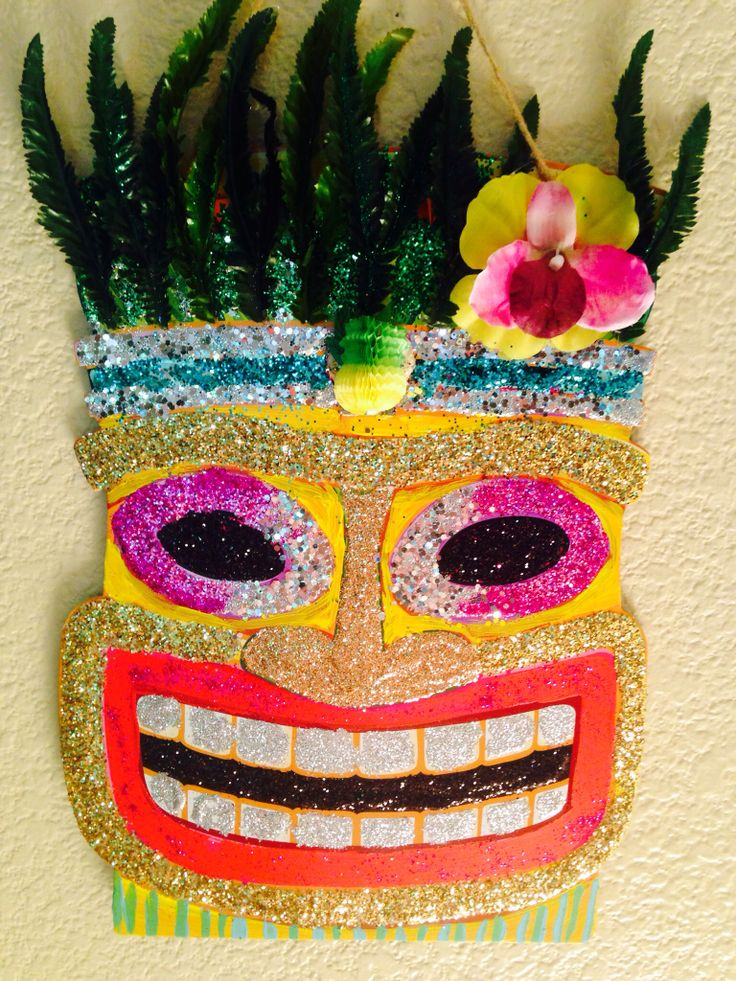 Dollar store tiki got a makeover with glitter and fake leaves!