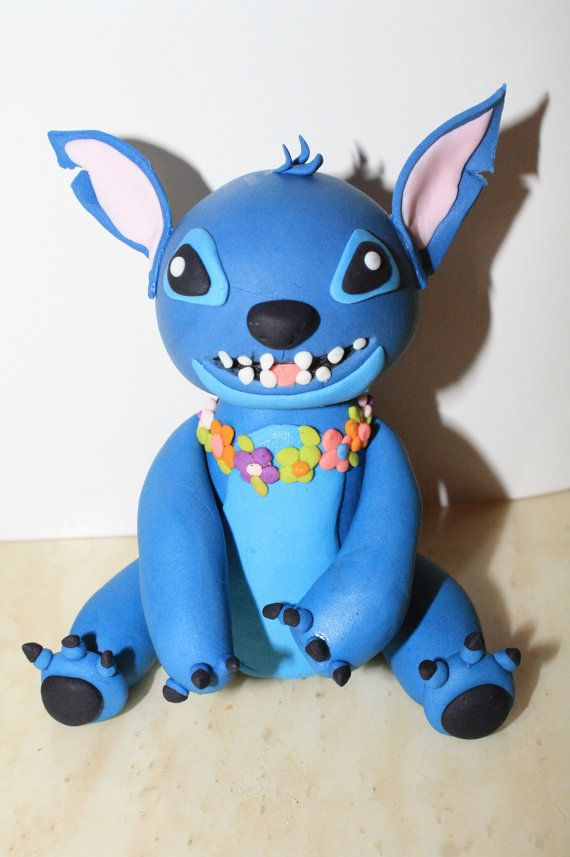 Wonderland Hand Sculpted Edible Lilo and Stitch cake topper on Etsy, $55.00