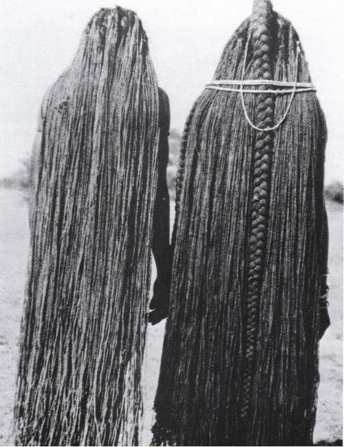 Africa | Two Mbalantu (Wambo group) women whose braids have been lengthened to their ankles through the use of sinew (eefipa) extensions. Namibia, | © M. Schettler, 1940s