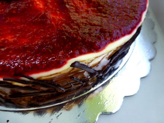 lemon-chocolate mousse cake with fresh raspberry sauce