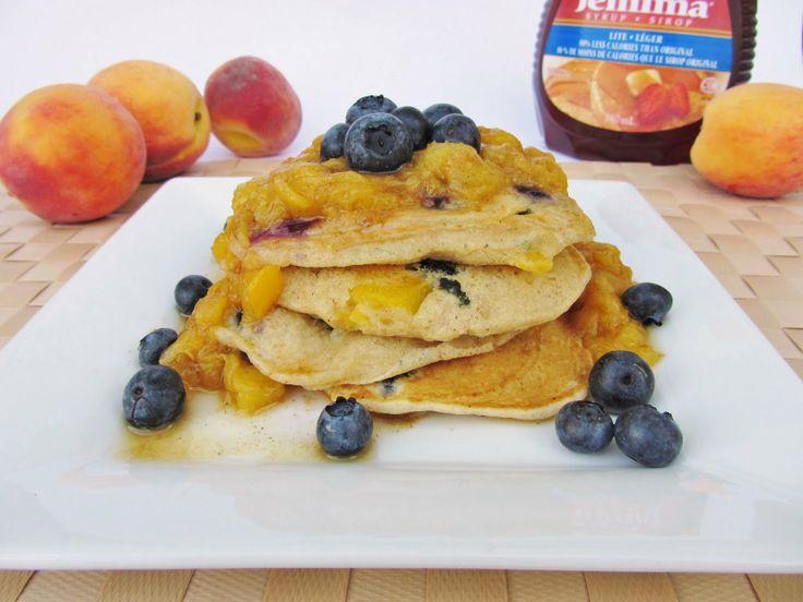 peach blueberry pancakes with warm cinnamon peach sauce