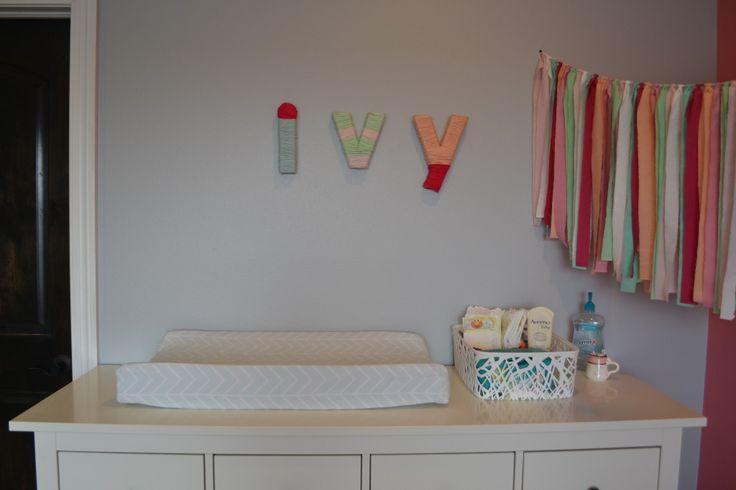Yarn-wrapped letters + ribbon garland = nursery love! #nursery #nurserydecor
