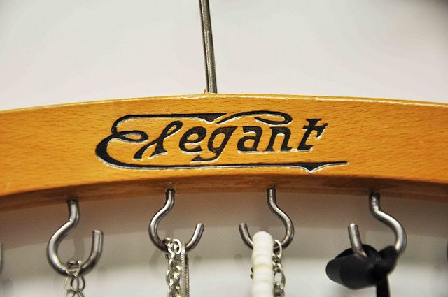 Wooden clothes hanger jewelry folder