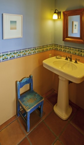 Here is a fun New Mexico Territorial style powder room from Home on the Range Interiors blog.homeontherangeinteriors.com that always makes me smile!