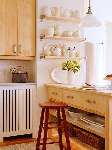"""Put a sliver of wall to work with a stack of shallow shelves to showcase a favorite collection. These natural-finish shelves feature brushed metal brackets to complement stainless-steel appliances. Or try contemporary """"floating"""" shelves with invisible brackets, available at home centers. If your style is more traditional, choose shelves with wooden supports, finished to match or accent the cabinets."""