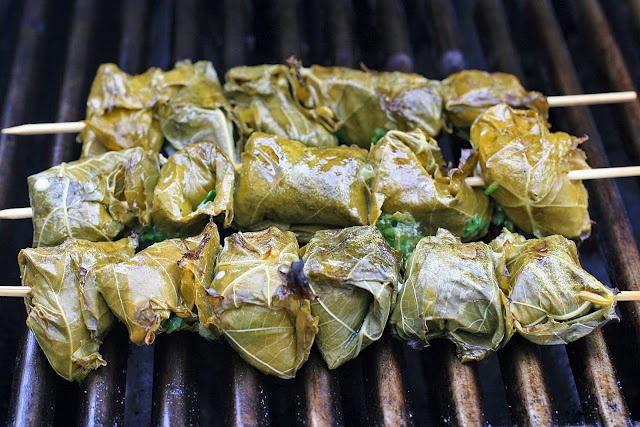 Grilled Fish Wrapped in Grape Leaves with Sweet and Sour Dipping Sauce ...